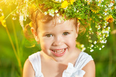funny-happy-baby-child-girl-wreath-nature-laughing-su-meadow-summer-56535271