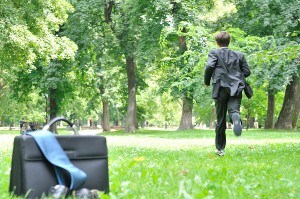 bigstock-Business-Man-Running-In-Park-158125942
